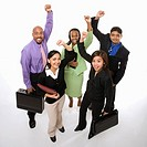 Portrait of multi_ethnic business group standing holding briefcases and cheering.