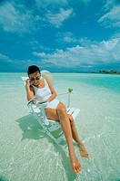 Young Woman Sitting On Beach Chair,Maldive Islands