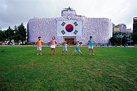 Kids In Front Of Taegeukgi_covered Cityhall,Seoul,Korea