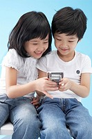 Girl and Boy Playing with Cellphone, Korea