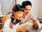 Father and Daughter Using Laptop, Korea