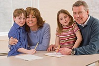 Happy family with homework