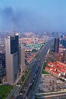 a Huge Highway Road in Shanghai, Surrounded By Skyscraper and Colorful Buildings Under a Blue Sky, Low Angle View, Shanghai, China
