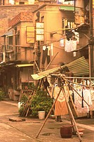 a Little Street in Shanghai, With Several Clotheslines With Clothes Hanging Outdoors, Side View, Shanghai, China