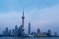 Several Shanghai Buildings, the Oriental Pearl Tower also Visual Under a Grey Sky, Low Angle View, Shanghai, China