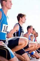 Male sprinters on starting blocks, side view (thumbnail)