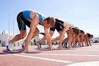 Male sprinters on starting blocks, low angle view (thumbnail)