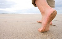 Woman on beach, close-up of feet, low section (thumbnail)