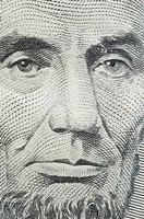 A close_up of a $5 bill.
