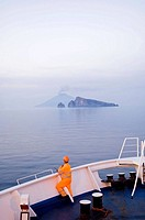 View of Stromboli and Basiluzzo from ferry boat. Eolian Islands, Sicily, Italy