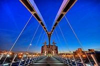 lowry pedestrian suspension footbridge and office block night dusk evening salford quays manchester england uk europe