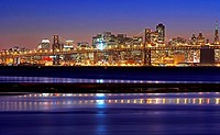 USA, California, San Francisco cityscape with Oakland Bay Bridge at dusk