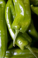 Pile of green peppers, full frame
