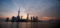 China, Shanghai, Pudong, skyline with Oriental Pearl TV Tower, sunset