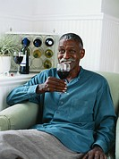 Senior man drinking wine, smiling