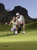 Man and woman playing golf