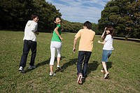 Friends having fun in park