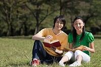 Couple studying in park
