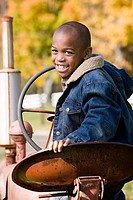 Portrait of a boy on a tractor (thumbnail)