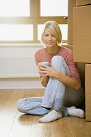 Woman taking a break from moving in