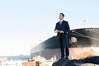 Businessman by ship