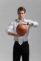 Man holding basketball in both hands