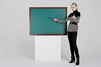 Woman standing in front of black board