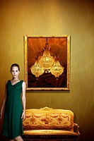 Composition of woman with antique sofa, frame