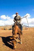 China, Xinjiang, Altay Massif, horseback Kazak shepherd