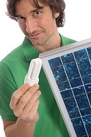 Man holding energy_saving bulb and solar panel