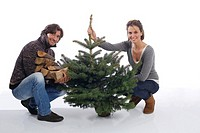 Couple with Christmas tree and firewood