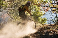 Italy, Southern Tyrol, man mountain biking