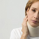 Mid adult woman in neck brace
