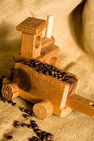 Little toy wooden train pulling a load of coffee beans. Homemade train.