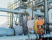 businessman,manager,businesswoman and two oil industry workers at refinery