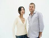 Portrait of couple standing in studio