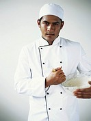 Chef standing with holding mixing bowl, portrait