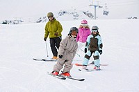 Family with two children 6-7 skiing