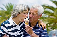 mature man feeding woman ice cream