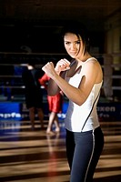 portrait of young woman posing in boxing gym