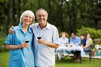 Middle_aged couple in back yard with glasses of wine portrait