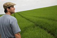 Man standing in field side view (thumbnail)
