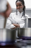Female chef in kitchen portrait