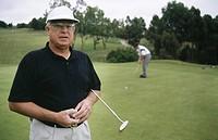 Senior men playing golf