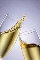 Two champagne glasses toasting close_up