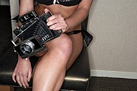 View of a camera hold by a woman.