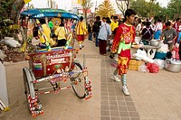 Pedicab in the Chingqy festival and participants  Thailand