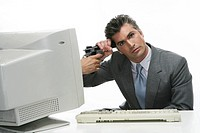 Man putting a gun sticking out of a computer to his head