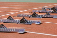 Track and field starting blocks at starting line (thumbnail)