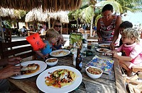 Netherlands Antilles, Curacao, family having lunch on the beach of the lions dive hotel